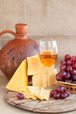 still life with grapes, cheese and wine photo
