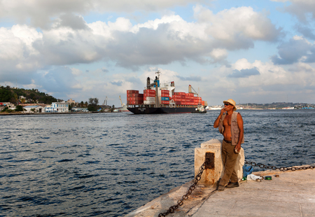 replenish: HAVANA, CUBA - MAY 19: Unknown Cuban fisherman catches a fish at the Malecon seawall in Havana. Fishing in the city helps to replenish the meager diet of poor people in Havana