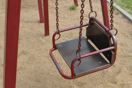 Childrens metal swing. The children grew up the swings were empty.