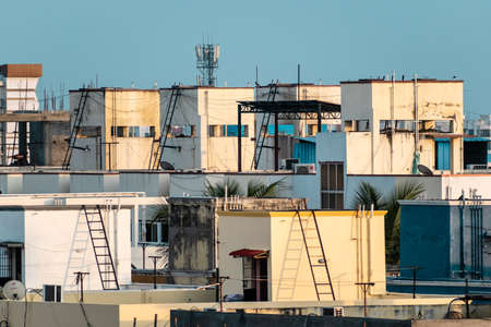 Chennai, Tamil Nadu, India - January 2020: Rooftops of a congested, modern low rise housing complex in the suburb of Pallavaram. Stock Photo