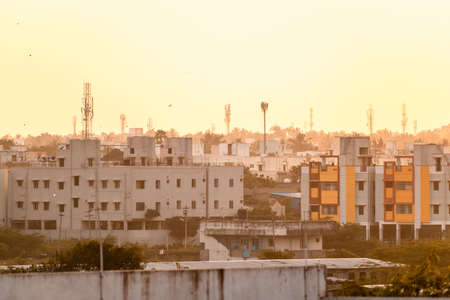 Chennai, Tamil Nadu, India - January 2020: A low rise cityscape during the golden hours of the evening in the suburb of Pallavaram.