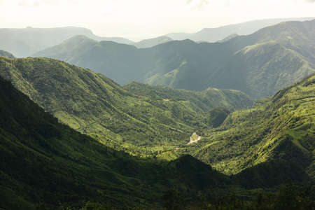 A wide green valley covered with forests in the Khasi Hills near Cherrapunjee in the state of Meghalaya in Northeast India.