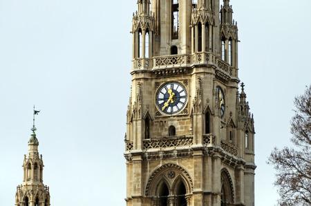 noon: Clock on the main tower of the Vienna city hall (Wiener Rathaus). Vienna, Austria.