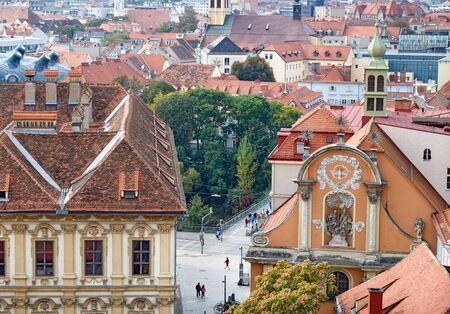 pedestrian bridge: View of the old town center of Graz with the church Dreifaltigkeitskirche in the foreground from the staircase of Schlossberg Hill. Graz, Austria. Stock Photo