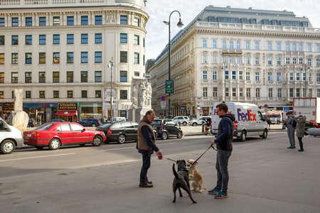 sidewalk talk: VIENNA, AUSTRIA - FEBRUARY, 22. Passers-by on the square in historic downtown ojn February 22, 2016 in Vienna, Austria.