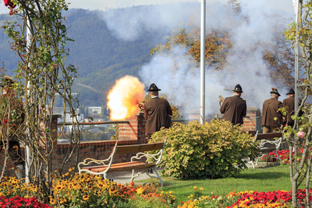 shooters: Celebratory gunfire in the fortress Schlossberg performed by the shooters from the Association of the Salzburger Fortress Shooters in the city of Graz, Austria.