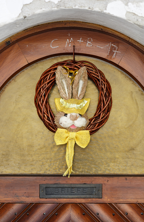 WEISSENKIRCHEN-IN-DER-WACHAU, AUSTRIA - APRIL 1, 2017. Easter Bunny on the front door of a residential house. Town Weissenkirchen-in-der-Wachau, Lower Austria. Editorial