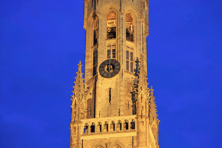 Dial of the Belfry of Bruges at night. Belgium