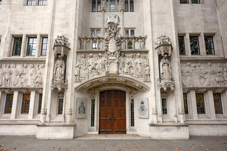middlesex: LONDON  UNITED KINGDOM - SEPTEMBER, 4. Entrace door of the Supreme Court of the United Kingdom on September, 4, 2016 in London. Editorial