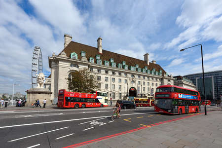 riverside county: LONDON  UNITED KINGDOM - AUGUST, 31. County Hall and Ferris wheel London eye on the south bank of the River Thames on August 31, 2016 in Westminster, London, England.