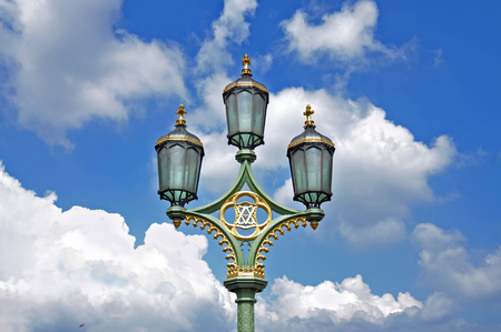 Street lamp on Westminster bridge on clouds background. London. Stock Photo