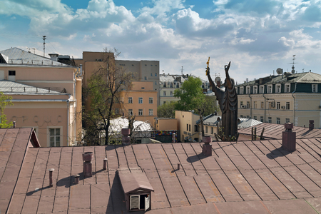 petrovka: Aerial view of the huge sculpture of a praying old believer woman and buildings around the courtyard of the Moscow Museum of Modern Art. Russia.