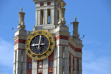 The clock on the tower of Moscow State University. Moscow, Russia. Editorial