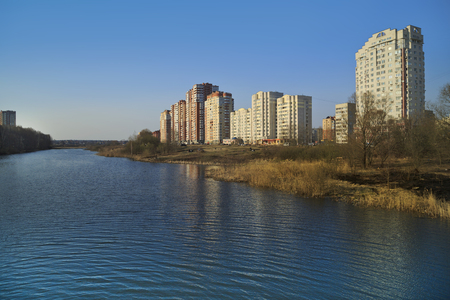 riverside landscaping: New residential district on the bank of the river Pekhorka. Balashikha, Moscow region, Russia. Stock Photo