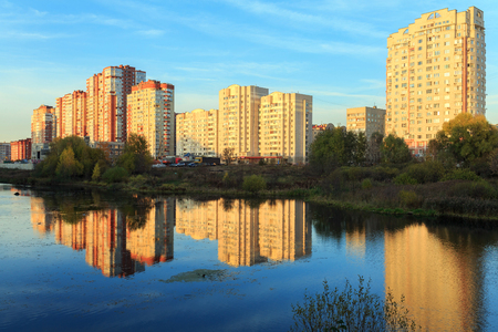 towerblock: New residential district on the bank of the river Pekhorka during sunset. Balashikha, Moscow region, Russia