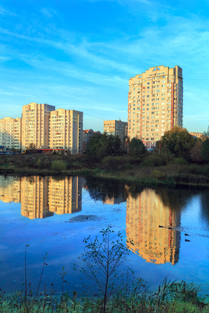towerblock: New residential district on the bank of the river Pekhorka during sunset