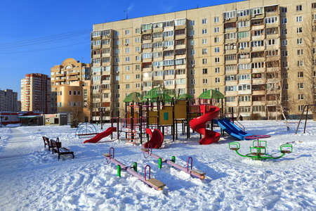 BALASHIKHA, RUSSIA - JANUARY, 21. A childrens playground on the background of a multi-storey panel residential building on January 21, 2016. Balashikha, Moscow region, Russia.