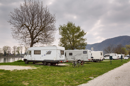 A campsite for RVs at the bank of the river Danube opposite the town Duernstein. Lower Austria.