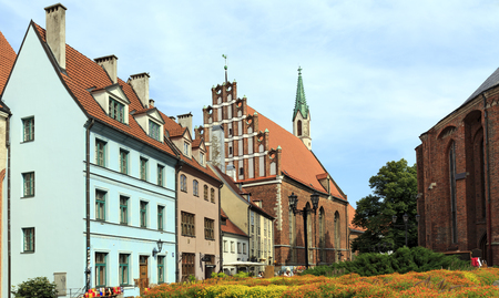 Old houses on the street Skarnu at the foot of St. Peters Church. Riga, Latvia. Editorial