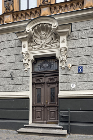 eclecticism: RIGA LATVIA - JULY 26. Door of the old apartment building, built in 1905 by Konstantins Peksens in art Nouveau style on Alberta street on July 26, 2015 in Riga Latvia.