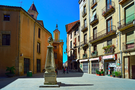 VIC SPAIN - MARCH, 27, 2015: Public stone drinking fountain on the square Placa del Pes. Vic, Spain. Editorial