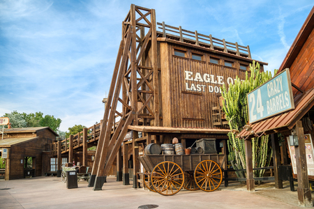PORT AVENTURA, SPAIN - MAY 11, 2015.  Attractions Crazy Barrels and Wild Buffalos in the Far West area of theme park Port Aventura in city Salou, Spain.