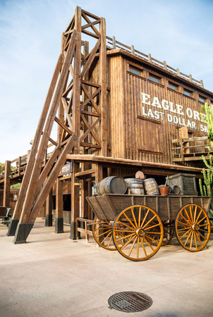 PORT AVENTURA, SPAIN - MAY 11, 2015. Old wooden wagon near the attraction Wild Buffalos in the Far West area of theme park Port Aventura in city Salou, Spain. Editorial