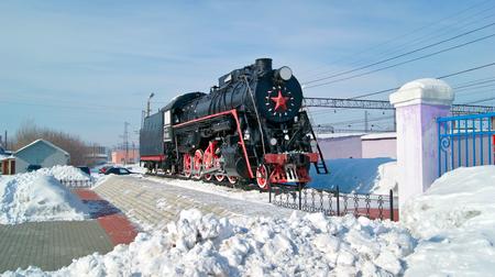 KAMENSK-URALSKIY  RUSSIA - FEBRUARY, 4. Old russian freight locomotive L-4305 on railway station square of the city Kamensk-Uralsky on February 4, 2011. Sverdlovsk region, Russian Federation.