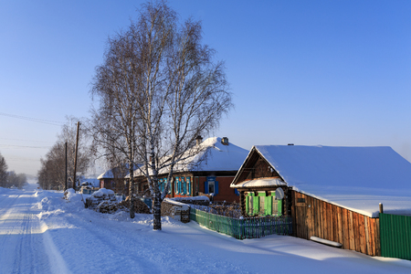 VISIM, RUSSIA - JANUARY, 8. Snow-covered russian old believer village in frosty sunny winter day on January 8, 2015 in village Visim, Ural region, Russia. Editorial