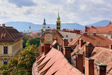 View of the old town center of Graz with the church Dreifaltigkeitskirche in the middle from the staircase of Castle Schlossberg Hill. Graz, Austria. 写真素材