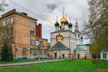 The Church of the Holy Trinity in Kozhevniki and all-Russian scientific research Institute of computer science and information technology. Moscow, Russia. Editorial