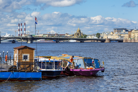 SAINT PETERSBURG, RUSSIA - JULY 2, 2017. Panorama of the Neva river: view of the pier for river vessels. Saint Petersburg, Russia.