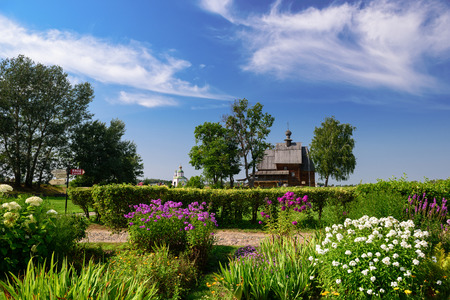 The wooden Church of St. Nicholas in the Kremlin of Suzdal, surrounded by flowers. Suzdal, Vladimir region, Golden Ring, Russia Stock Photo