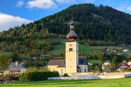 St. Johns Church in the alpine village Obermillstatt, situated within the Gurktal Alps (Nock Mountains). State of Carinthia, Austria. Stock Photo