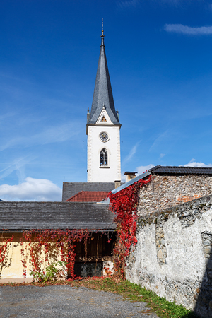 Historical center of Gmuend in the fall. Gothic parish church. Gmuend in Kaernten, district of Spittal an der Drau, federal state of Carinthia,  Austria Stock Photo