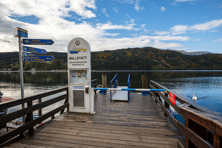 MILLSTATT AM SEE AUSTRIA - OCTOBER 8, 2017. Ship station on the Millstatt lake (german: Millstaettersee) in the fall. Town of Millstatt am See, situated on the southern slope of the Gurktal Alps in the state of Carinthia, Austria. Editorial