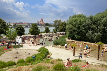 VIENNA AUSTRIA - JULY 9, 2017. Donauinsel water playground for children on the Danube island. View of the Danube river and St. Francis of Assisi Church. District Donaustadt, Vienna, Austria. Editorial