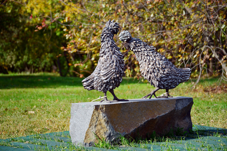 MOSCOW RUSSIA - OCTOBER 4, 2014. Sculpture of two roosters in the Kolomenskoye park. Moscow, Russia Editorial