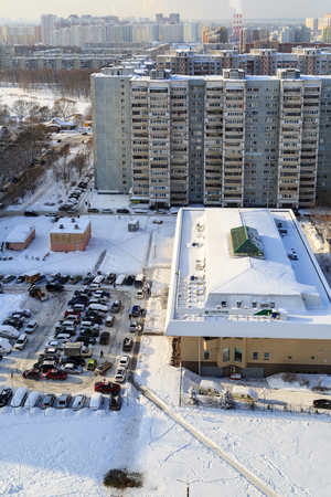 BALASHIKHA RUSSIA - FEBRUARY 1, 2018. Aerial view of the residential houses and the Bank building with a parking in front of it. Balashikha. Moscow region, Russia.