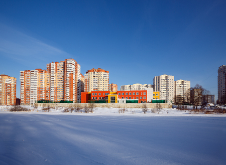 A new residential district with kindergarten on the banks of the river Pekhorka. Balashikha, Moscow region, Russia.