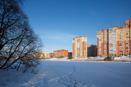 A new residential district on the banks of the river Pekhorka in winter. Balashikha, Moscow region, Russia.