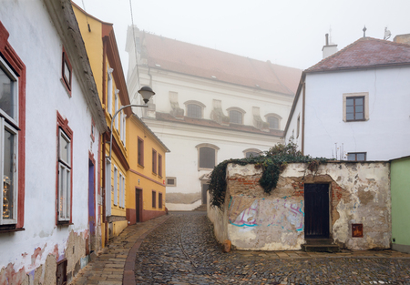 View of the old residential street leading to the Archangel Michael Church. Historical downtown of Znojmo, Czech Republic, Europe.