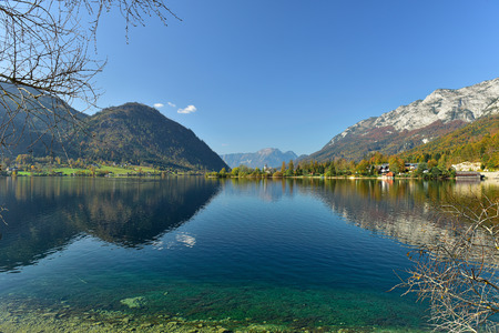 View of the lake Grundlsee in the early autumn morning, framed by the mountain range Totes Gebirge. Region Salzkammergut, Liezen district of Styria, Austria, Europe.