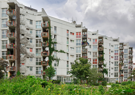 VIENNA, AUSTRIA - JULY 22, 2018. Multi-apartment residential building overgrown with plants. District of Favoriten, Vienna, Austria