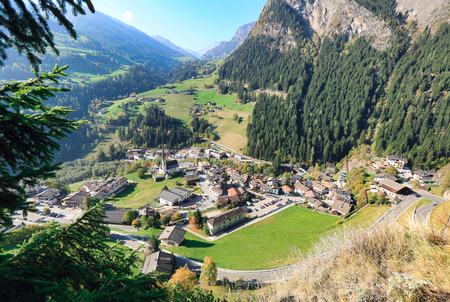 View down to the alpine village of Moos in Passeier and across the Passeiertal valley from Garnets viewpoint. Stubai Alps, South Tyrol, Italy. 写真素材
