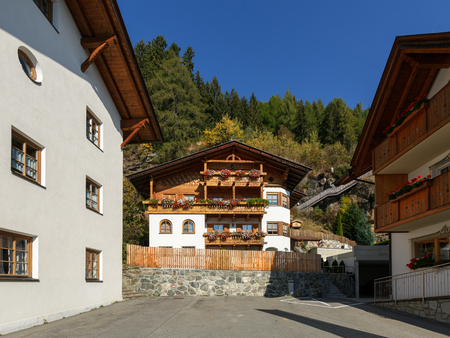 Alpine village of Stulles in province on a sunny autumn day. Municipality of Moos in Passeier, South Tyrol, Italy.