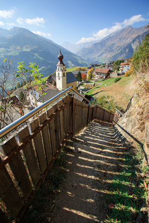 View down to the alpine village of Stulles in province of  the fall. Municipality of Moos in Passeier, Stubai Alps, South Tyrol, Italy.