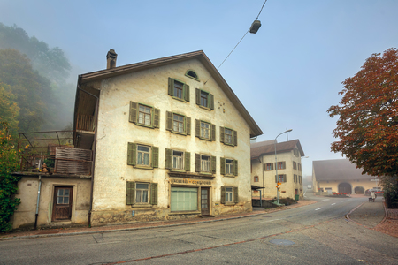 VILLIGEN, SWITZERLAND - OCTOBER 19, 2018. Old bakery and confectionery house on a foggy autumn day in the town of Villigen, district of Brugg, canton of Aargau, Switzerland