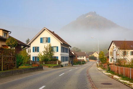 Residential neighborhood on a foggy autumn morning in the town of Villigen, district of Brugg, canton of Aargau, Switzerland, Europe.