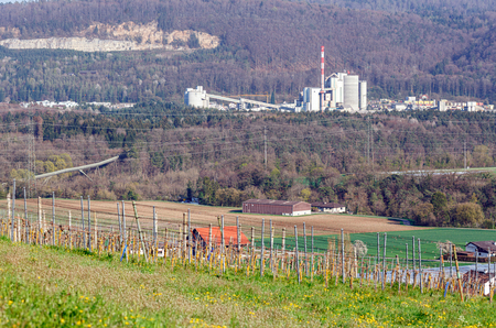 View of the cement plant in Wuerenlingen from village of Villigen, Brugg district, canton of Aargau, Switzerland, Europe. 写真素材